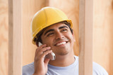 Close up of construction worker talking on cell phone