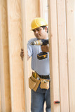 Construction worker drilling wood