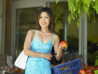Portrait of woman holding apple