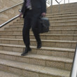 Blurred view of businessman's legs descending stairs