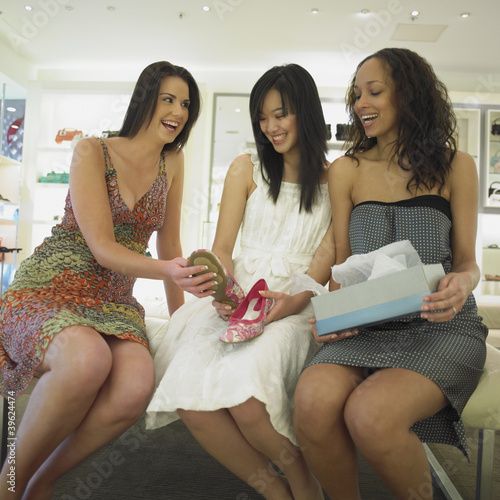 Young women shopping for shoes together