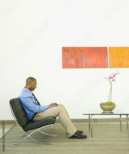 Businessman working on a couch