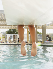 Feet dangling off the end of a diving board