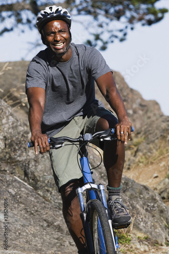Male cyclist in rugged terrain