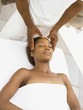 Young woman having a scalp massage