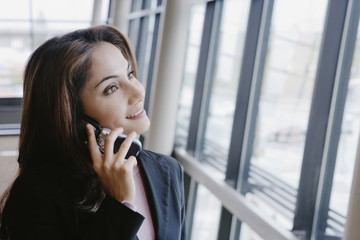 Businesswoman talking on her cell phone