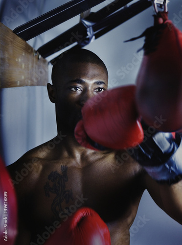Male boxer using a punching bag