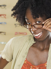 Young woman trying on new glasses