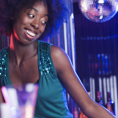 Young woman at a dance club