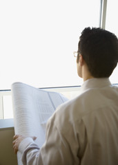Businessman examining blueprints