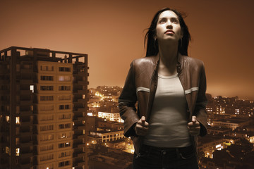 Woman overlooking urban area