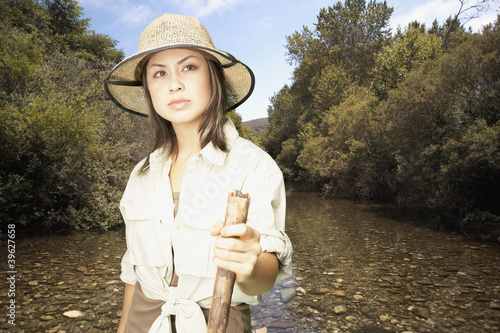 Explorer standing in riverbed
