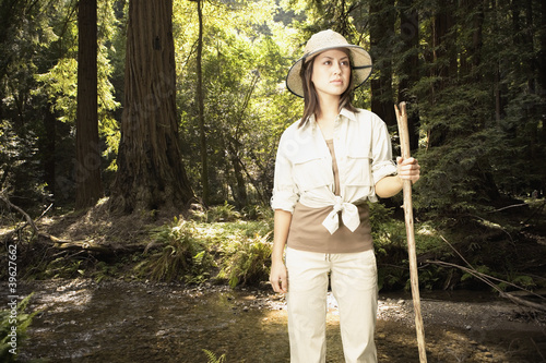 Explorer standing in forested area