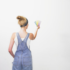 Woman looking at paint color swatches