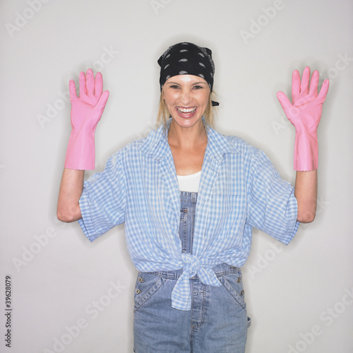 Woman wearing rubber dishwashing gloves