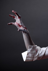 Creepy zombie hand, extreme body-art