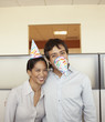 Co-workers joking around at office party
