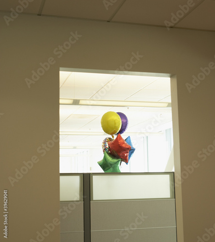 Bunch of balloons in office cubicle