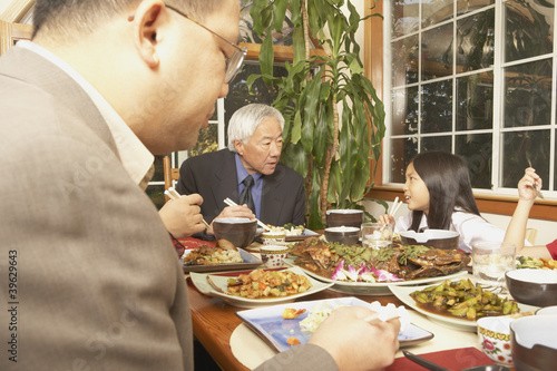 Asian family eating at the dinner table