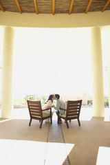 Couple kissing on patio at hotel