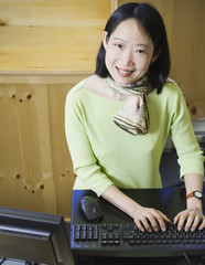 Middle-aged Asian businesswoman smiling