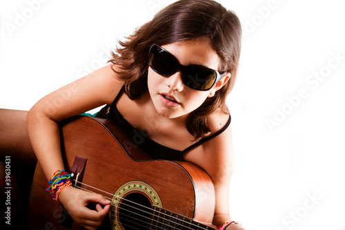 Young girl playing guitar, landscape