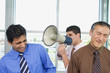 Group of businessmen with megaphone