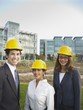 Group of business people wearing hard hats