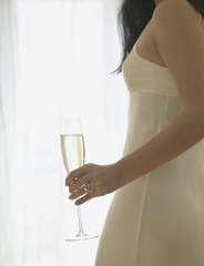 Close up of woman holding champagne glass