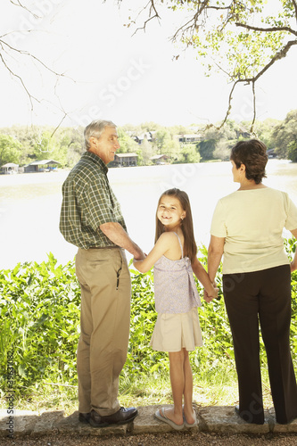 Hispanic girl with grandparents outdoors