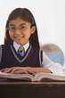 Young Hispanic girl at desk in classroom