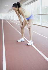 Female runner on indoor track