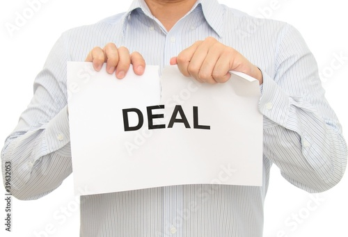 Man tearing Deal sign
