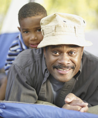African father and son smiling