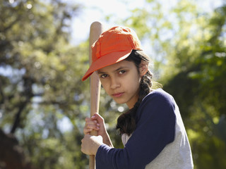 Hispanic girl with baseball bat