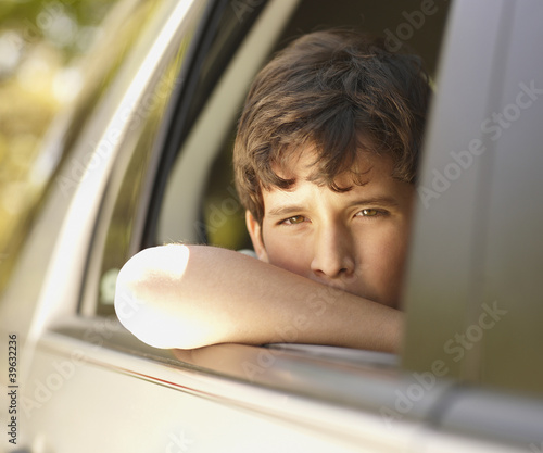 Boy leaning out of car window