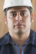 Close up of Hispanic man wearing hard hat