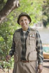 Senior Hispanic man with fishing gear