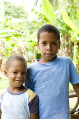 two children smiling portrait Corn Island Nicaragua