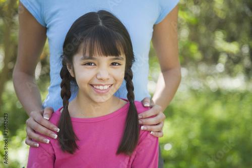 Hispanic girl smiling outdoors