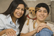 Hispanic mother and son with small dog