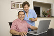Senior Hispanic couple with credit card and laptop