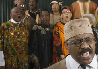 Group of middle-aged African people singing