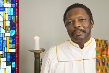 African man wearing church choir gown