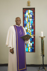 Senior African in church choir gown