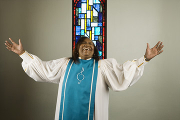 African woman wearing church choir gown and singing