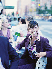 Businesswoman at outdoor restaurant laughing