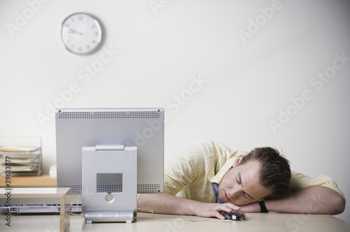 Businessman sleeping on desk