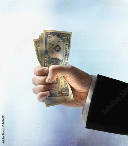 Businessman's hand holding US dollars