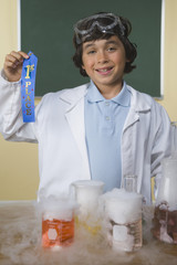 Young boy with science project holding first place ribbon